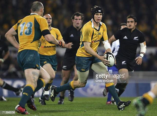 Steve Larkham of the Wallabies makes a break during the Tri Nations series Bledisloe Cup match between the New Zealand All Blacks and the Australian...