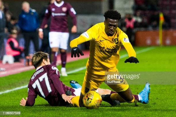 Steve Lawson of Livingston is tackled by Ryotaro Meshino of Hearts during the Scottish Premier League match between Hearts and Livingston at...