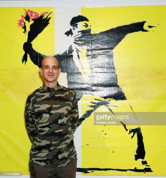 Steve Lazarides poses during a media preview for The Art of Banksy on September 12, 2019 in Sydney, Australia.