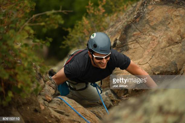 Steve Leibrandt from Michigan reaches the top while climbing with his son 15 year old Jacob Leibrandt and his brother Dave Leibrandt of Superior on...