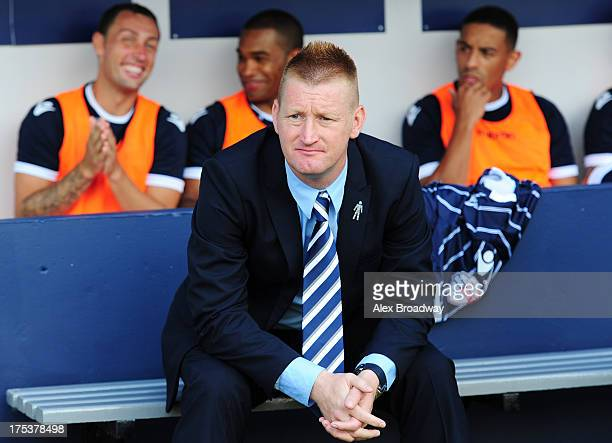 Steve Lomas manager of Millwall looks on from the dugout before the Sky Bet Championship match between Millwall and Yeovil Town at The Den on August...