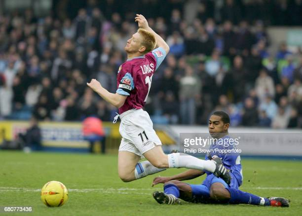 Steve Lomas of West Ham and Marvin Elliott of Millwall in action during the Coca Cola League Championship match between Millwall and West Ham United...