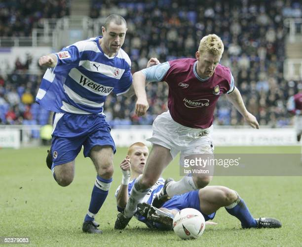 Steve Lomas of West Ham is tackled by Steve Sidwell and Andy Hughes of Reading during the CocaCola Championship match between Reading and West Ham...