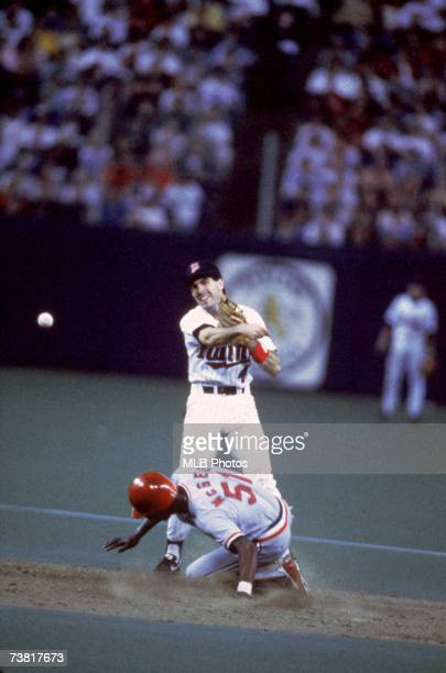 Steve Lombardozzi of the Minnesota Twins throws to first as outfielder Willie McGee of the St Louis Cardinals is forced at second base during the...