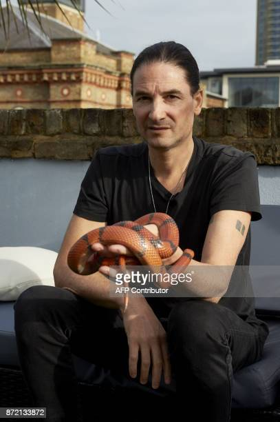 Steve Ludwin poses with a Honduran milk snake outside his apartment in Kennington south London on November 9 2017 For nearly 30 years Steve Ludwin...