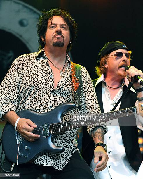 Steve Lukather and Joseph Williams of Toto perform at Chastain Park Amphitheater on August 14 2013 in Atlanta Georgia