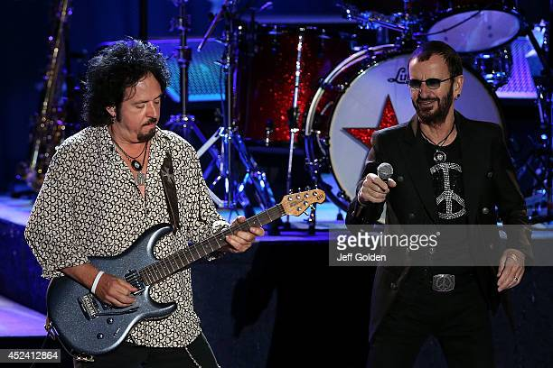 Steve Lukather and Ringo Starr of Ringo Starr and his All Starr Band perform at The Greek Theatre on July 19 2014 in Los Angeles California