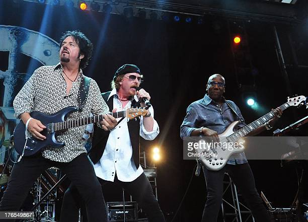 Steve Lukather Joseph Williams and Nathan East of Toto perform at Chastain Park Amphitheater on August 14 2013 in Atlanta Georgia