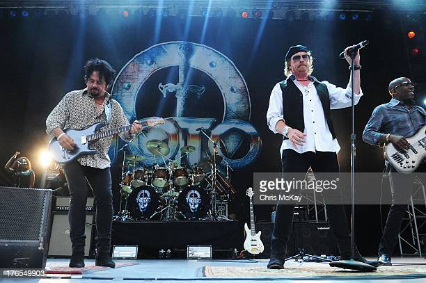 Steve Lukather Simon Phillips Joseph Williams and Nathan East of Toto perform at Chastain Park Amphitheater on August 14 2013 in Atlanta Georgia