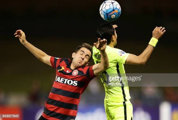 Steve Lustica of the Wanderers competes for the ball against Ryota Moriwaki of Urawa Red Diamonds during the AFC Asian Champions League match between...