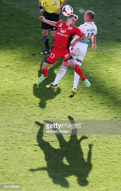 Steve Lustica of United and Jamie Maclaren of the Glory contest for the ball during the round one A-League match between Perth Glory and Adelaide...