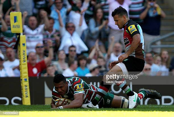 Steve Mafi of Leicester dives over to score his team's opening try as Danny Care of Harlequins closes in during the Aviva Premiership final between...