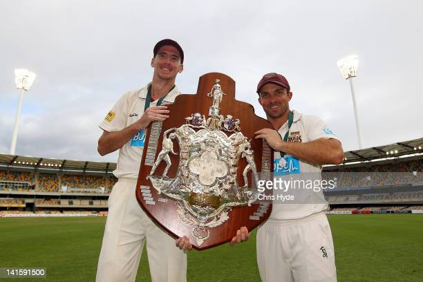 Steve Maggofin and Chris Hartley of the Bulls hold the Sheffield Shield after winning on day four of the Sheffield Shield match between the...