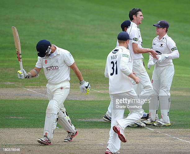 Steve Magoffin of Sussex celebrates with team-mates after claiming the wicket of Phil Jaques of Yorkshire during day two of the LV County...