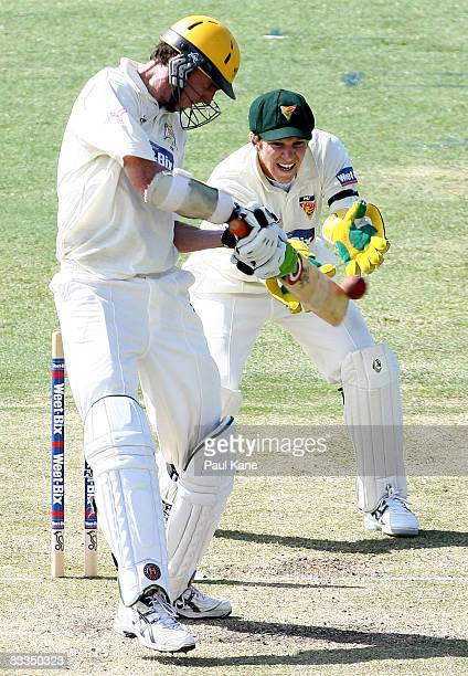 Steve Magoffin of the Warriors plays a cut shot during day two of the Sheffield Shield match between the Western Australian Warriors and the...