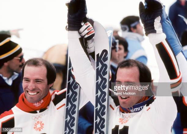Steve Mahre and Phil Mahre of the USA celebrate their silver and gold medal wins in the Slalom event of the Alpine Skiing competition of the 1984...