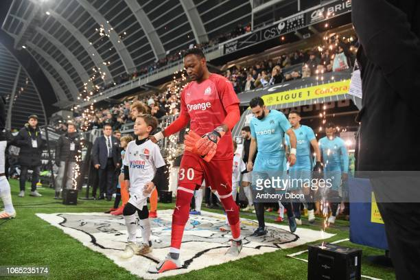 Steve Mandanda Adil Rami and Lucas Ocampos of Marseille during the Ligue 1 match between Amiens and Marseille at Stade de la Licorne on November 25...