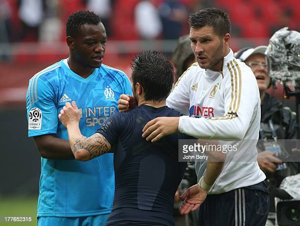 Steve Mandanda goalkeeper of OM Mathieu Valbuena of OM and AndrePierre Gignac of OM congratulate each other after the French Ligue 1 match between...