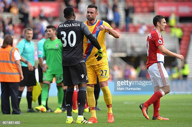 Steve Mandanda of Crystal Palace and Damien Delaney of Crystal Palace embrace after the game during the Premier League match between Middlesbrough...