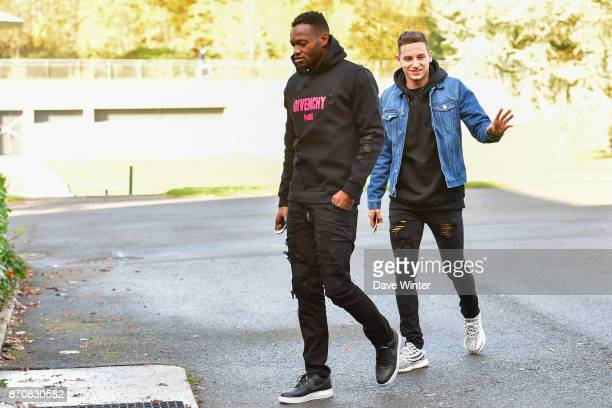 Steve Mandanda of France and Florian Thauvin of France arrive at the Centre National du Football in Clairefontaine en Yvelines France on November 6...