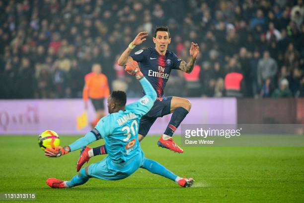 Steve Mandanda of Marseille receives a red card for handling a ball from Angel Di Maria of PSG outside his penalty area during the Ligue 1 match...