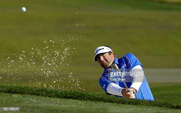 Steve Marino hits a bunker shot during the second round of the ATT Pebble Beach National ProAm at the Monterey Peninsula Country Club on February 8...