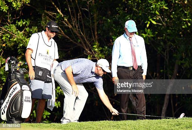 Steve Marino measures a club length after hitting into the rough on the 18th hole during the third round of the Puerto Rico Open at Coco Beach on...