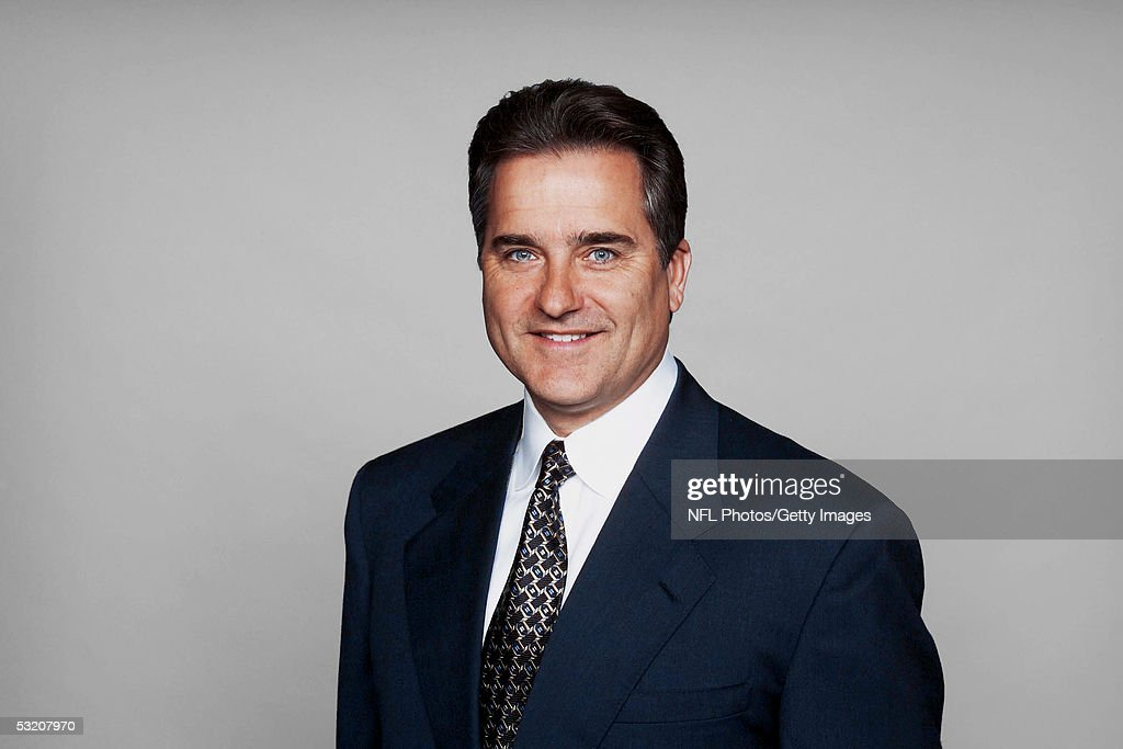 Steve Mariucci of the Detroit Lions poses for his 2005 NFL headshot at photo day in Detroit, Michigan.