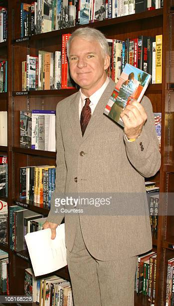 Steve Martin holds up a copy of his book 'The Pleasure of Myself'