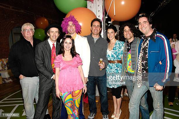 Steve Martin of The Agency Group with comedian Jerry Seinfeld and wife Jessica pose for pictures with The Dirty Sock Funtime Band at the Baby Buggy...