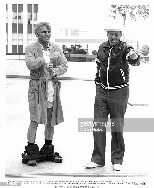 Steve Martin with pants down stands with director Carl Reiner in a scene from the film 'The Jerk' 1979