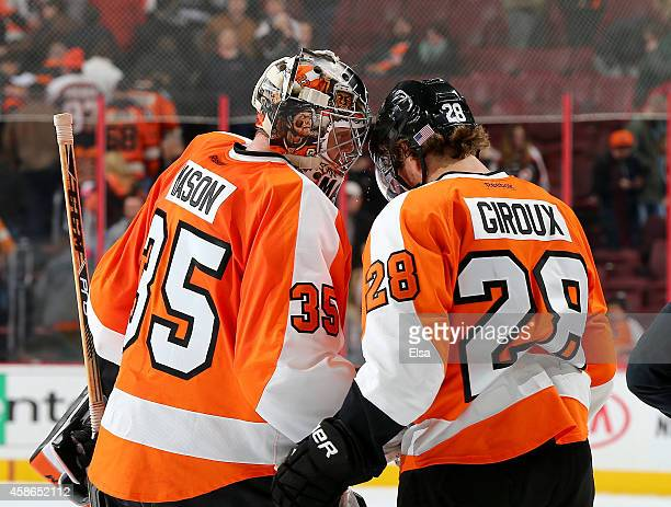 Steve Mason and Claude Giroux of the Philadelphia Flyers celebrate the win over the Colorado Avalanche on November 8 2014 at the Wells Fargo Center...