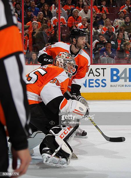 Steve Mason and Nick Schultz of the Philadelphia Flyers watch the play in their zone against the New York Rangers on January 16, 2016 at the Wells...
