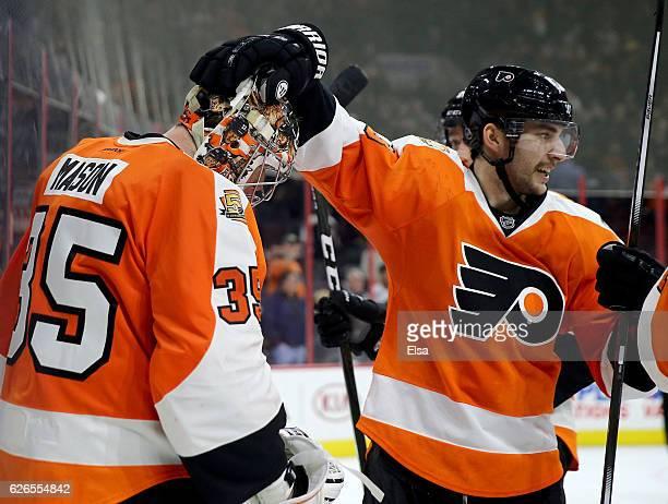 Steve Mason and Shayne Gostisbehere of the Philadelphia Flyers celebrate the win over on November 29 2016 at Wells Fargo Center in Philadelphia...