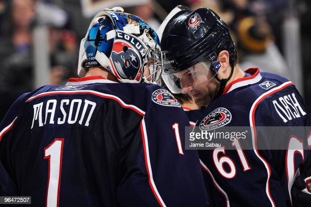 Steve Mason is congratulated by teammate Rick Nash both of the Columbus Blue Jackets after Mason stopped all 28 shots that he faced in 40 shutout...