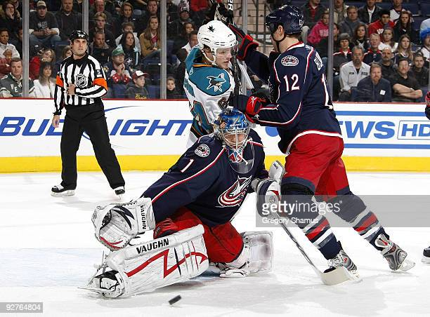 Steve Mason of the Columbus Blue Jackets makes a save in front of teammate Mike Blunden and Jamie McGinn of the San Jose Sharks on November 4 2009 at...
