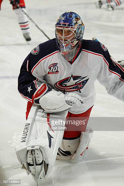 Steve Mason of the Columbus Blue Jackets stretches on the ice against the San Jose Sharks during an NHL game on November 20 2010 at HP Pavilion at...