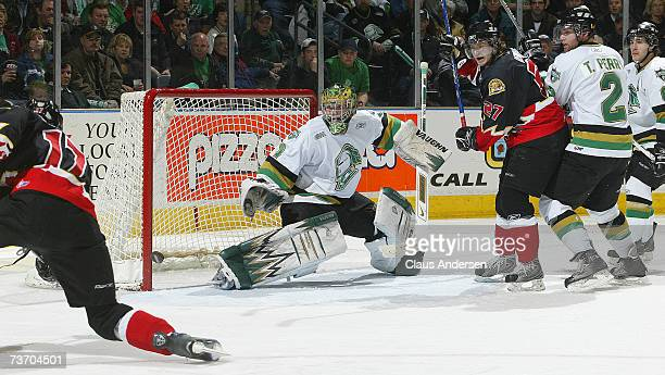 Steve Mason of the London Knights slides across to face a shot from Wayne Simmonds of the Owen Sound Attack in game one of playoffs at the John...