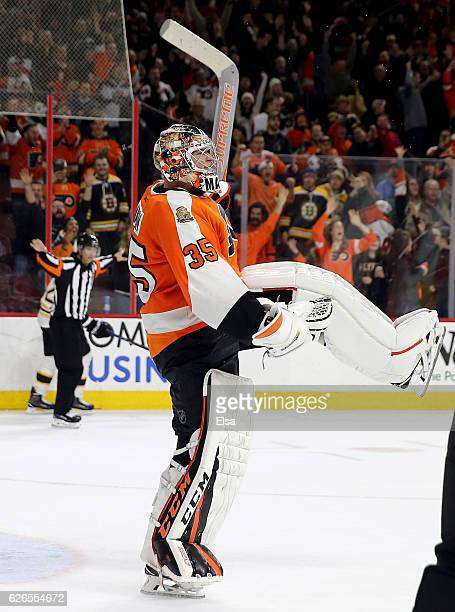 Steve Mason of the Philadelphia Flyers celebrates after he made the game winning save in the overtime shootout against the Boston Bruins on November...