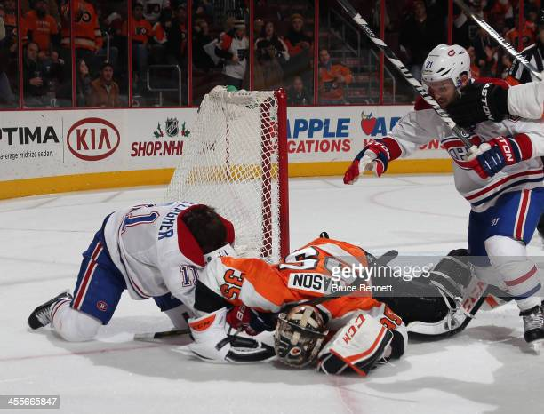 Steve Mason of the Philadelphia Flyers fights with Brendan Gallagher of the Montreal Canadiens at the closing buzzer during the Flyers 2-1 victory...
