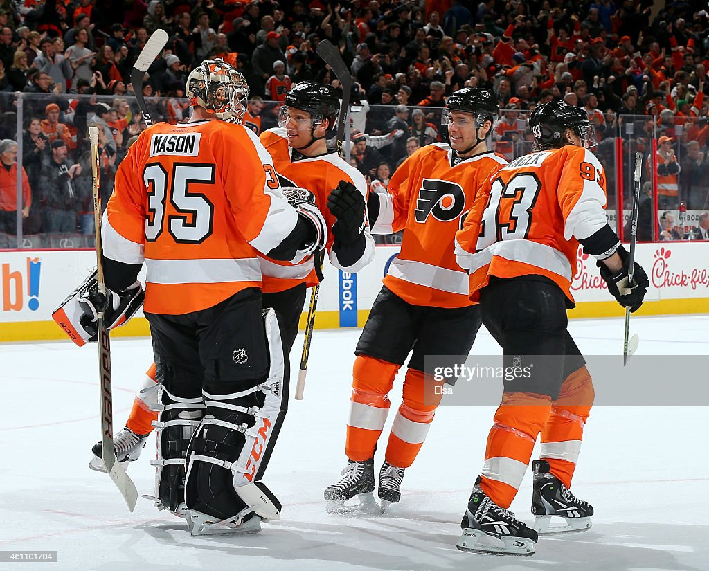Steve Mason #35 of the Philadelphia Flyers is congratulated by teammates Brayden Schenn #10,Chris Vande Velde #76 and Jakub Voracek #93 after the overtime shootout on January 6, 2015 at the Wells Fargo Center in Philadelphia, Pennsylvania.The Philadelphia Flyers defeated the Ottawa Senators 2-1 in an overtime shootout.