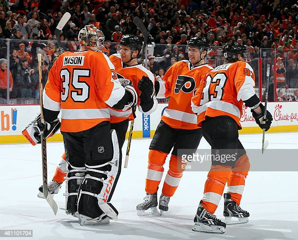 Steve Mason of the Philadelphia Flyers is congratulated by teammates Brayden SchennChris Vande Velde and Jakub Voracek after the overtime shootout on...