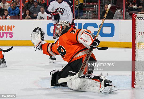 Steve Mason of the Philadelphia Flyers makes a glove save against the Columbus Blue Jackets on December 5 2015 at the Wells Fargo Center in...