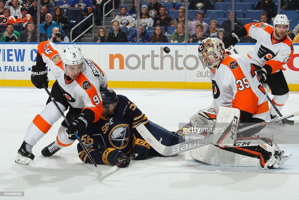 Steve Mason #35 of the Philadelphia Flyers makes a third period save as Justin Bailey #56 of the Buffalo Sabres and Ivan Provorov #9 battle for the rebound during an NHL game at the KeyBank Center on March 7, 2017 in Buffalo, New York.