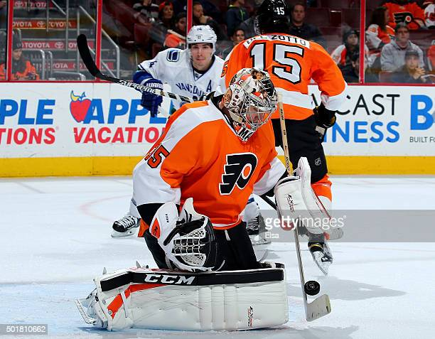 Steve Mason of the Philadelphia Flyers stops a shot in the third period against the Vancouver Canucks on December 17 2015 at the Wells Fargo Center...
