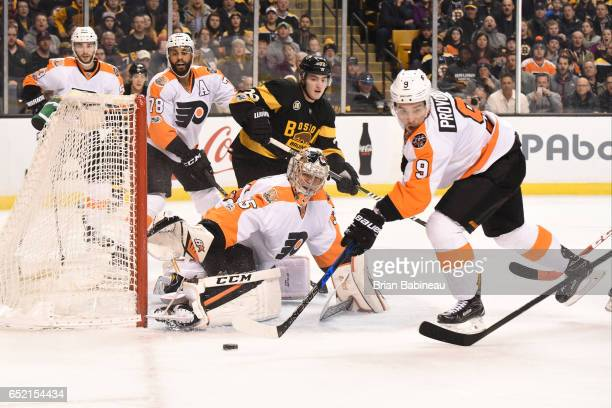 Steve Mason of the Philadelphia Flyers watches the loose puck against the Boston Bruins at the TD Garden on March 11 2017 in Boston Massachusetts