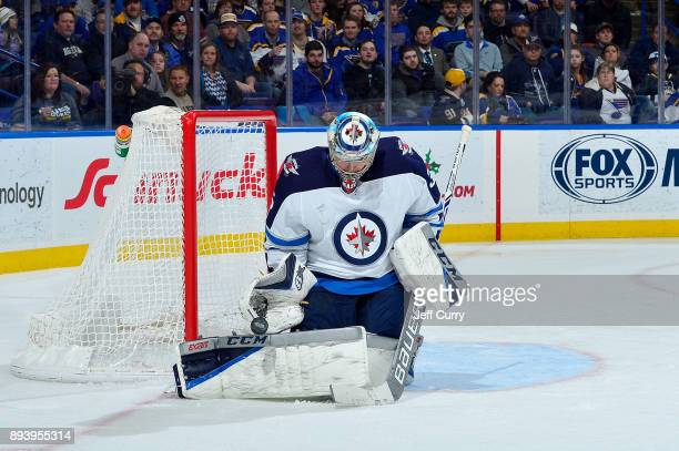 Steve Mason of the Winnipeg Jets defends the net against the St Louis Blues at Scottrade Center on December 16 2017 in St Louis Missouri