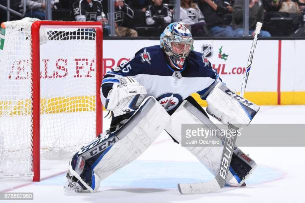 Steve Mason of the Winnipeg Jets defends the net during a game against the Los Angeles Kings at STAPLES Center on November 22 2017 in Los Angeles...