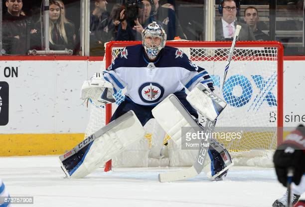 Steve Mason of the Winnipeg Jets gets ready to make a save against the Arizona Coyotes at Gila River Arena on November 11 2017 in Glendale Arizona