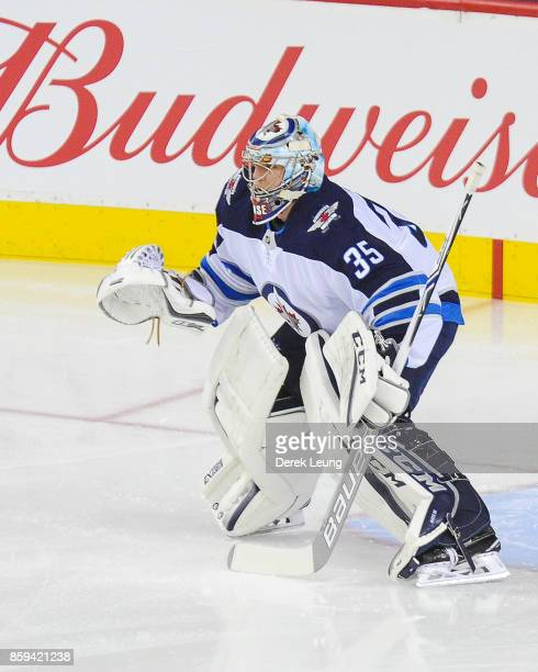 Steve Mason of the Winnipeg Jets in action against the Calgary Flames during an NHL game at Scotiabank Saddledome on October 7 2017 in Calgary...